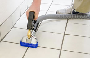 Darren Varney cleaning a tiled floor