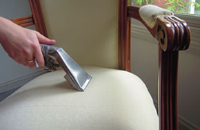 Cleaning the upholstery of a chair